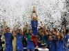Italy's Fabio Cannavaro (C) lifts the World Cup Trophy as he celebrates with team mates after the World Cup 2006 final soccer match between Italy and France in Berlin July 9, 2006.  FIFA RESTRICTION - NO MOBILE USE     REUTERS/Michael Dalder    (GERMANY)