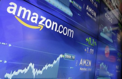 The Amazon logo is displayed at the Nasdaq MarketSite, in New York's Times Square, Tuesday, May 30, 2017. Online retail giant Amazon.com traded above $1,000 a share for the first time. (ANSA/AP Photo/Richard Drew) [CopyrightNotice: AP]