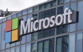 FILE - This April 12, 2016 file photo shows the Microsoft logo in Issy-les-Moulineaux, outside Paris, France.  The cyberextortion attack hitting dozens of countries was a perfect storm of sorts. It combined a known and highly dangerous security hole in Microsoft Windows, tardy users who didnt apply Microsofts March software fix, and a software design that allowed the malware to spread quickly once inside university, business and government networks. (ANSA/AP Photo/Michel Euler, File) [CopyrightNotice: Copyright 2017 The Associated Press. All rights reserved.]