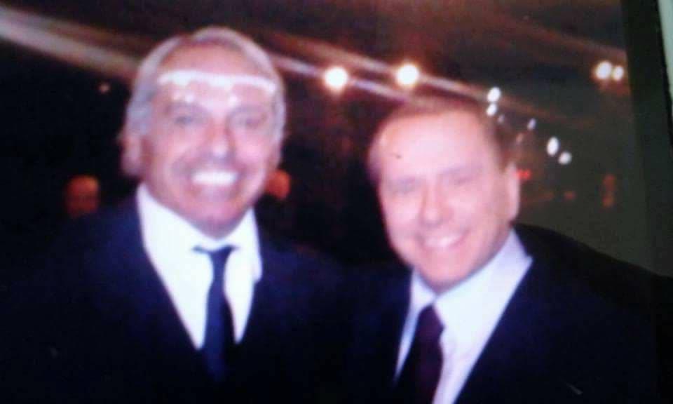 Brucola con Berlusconi